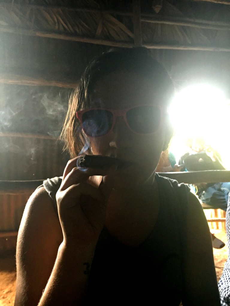 Smoking a cigar in vinales
